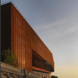 波兰博物馆外墙的橙色方孔穿孔铝板